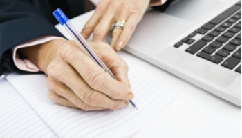 Woman writing with pen